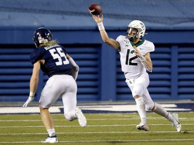 Baylor quarterback Charlie Brewer (12) passes the ball as Rice linebacker Blaze Alldredge (55) closes in during the second half of an NCAA college football game Saturday, Sept. 21, 2019, in Houston.