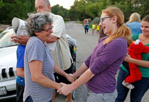 Kate Kendrick (right), 12, shares a laugh with Joan Tober after the Kendrick family arrived in FriscoonMay 25. (Jae S. Lee/Staff Photographer)