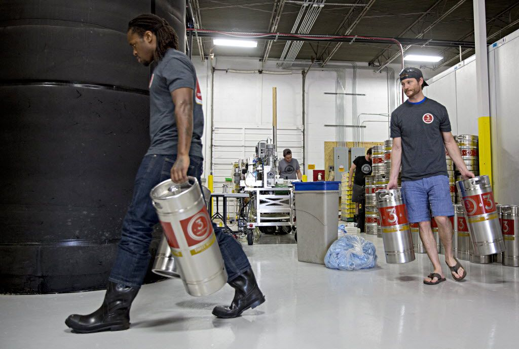 Steven Aikens (left) and Gavin Secchi prepare to fill kegs at 3 Nations Brewing Friday, October 16, 2015 in Farmers Branch, Texas. Secci founded the brewery, which has been in operation for about four months and currently produces three different kinds of beer.