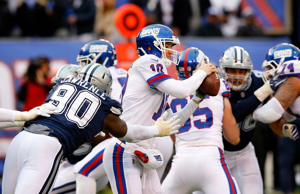 Cowboys defensive end DeMarcus Lawrence (90) pressures New York Giants quarterback Eli Manning (10) during the third quarter of a game at MetLife Stadium in East Rutherford, N.J., on Sunday, Dec. 10, 2017. (Tom Fox/The Dallas Morning News)