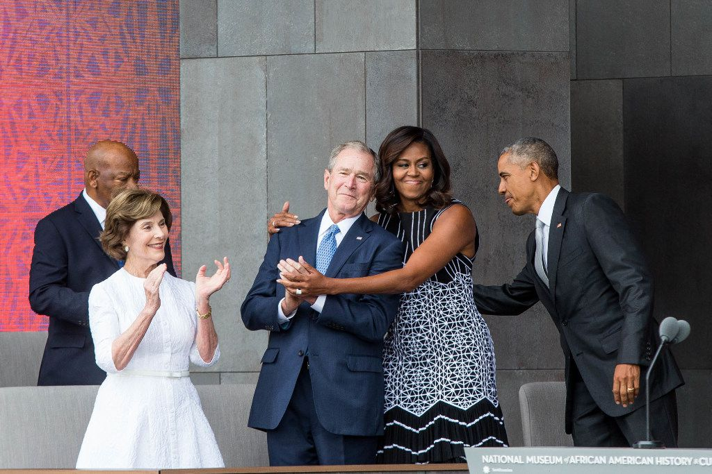 Former First Lady Laura Bush, former US President George W. Bush, First Lady Michelle Obama, and President Barack Obama attend the opening ceremony for the Smithsonian National Museum of African American History and Culture in Washington, D.C.