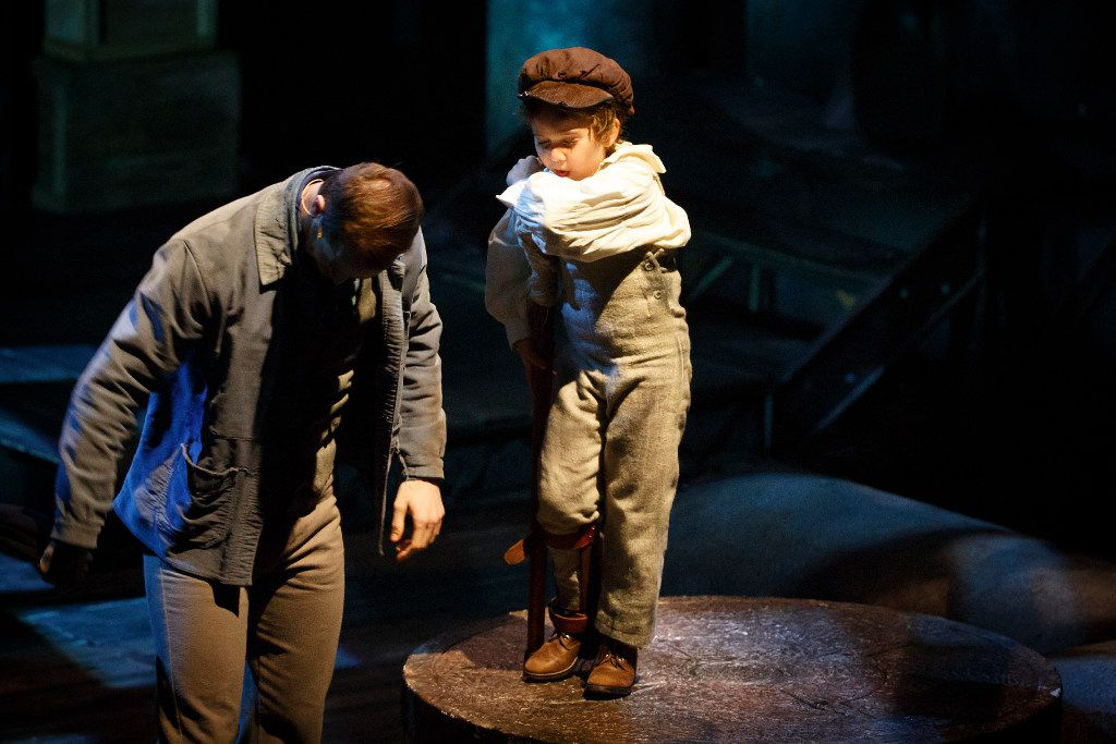 Alex Organ, as Bob Cratchit, takes center stage with Nina Ruby Gameros, as Tiny Tim, during Dallas Theater Center's performance of 'A Christmas Carol' at the Wyly Theatre on Tuesday,Nov. 29, 2016, in Dallas.