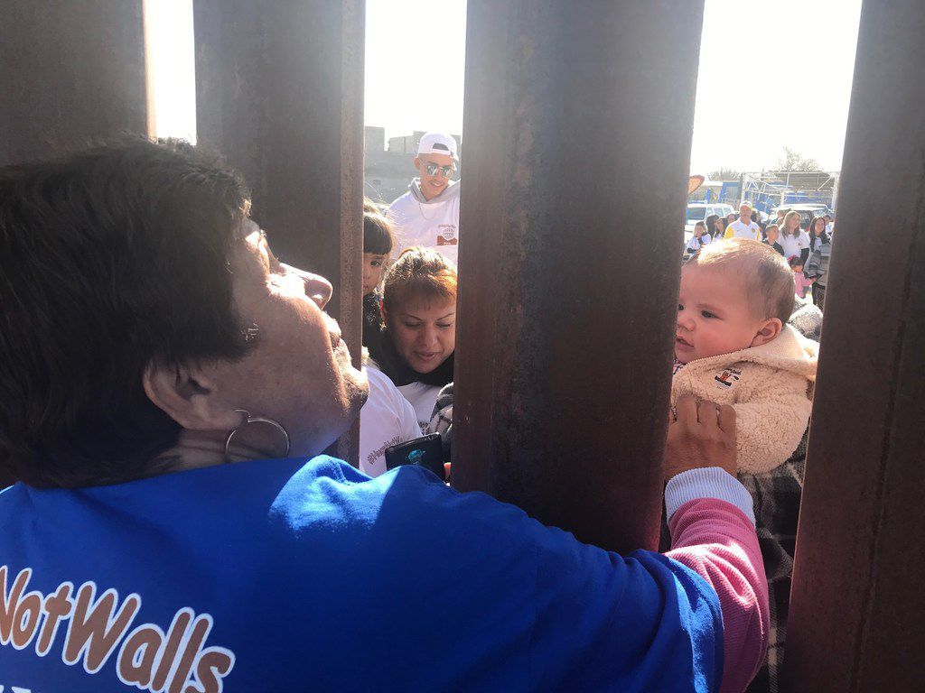 Families split by deportation were briefly reunited in December 2017 at the border fence between Mexico and Sunland Park, N.M. The Hugs not Walls event was sponsored by the Border Network for Human Rights.