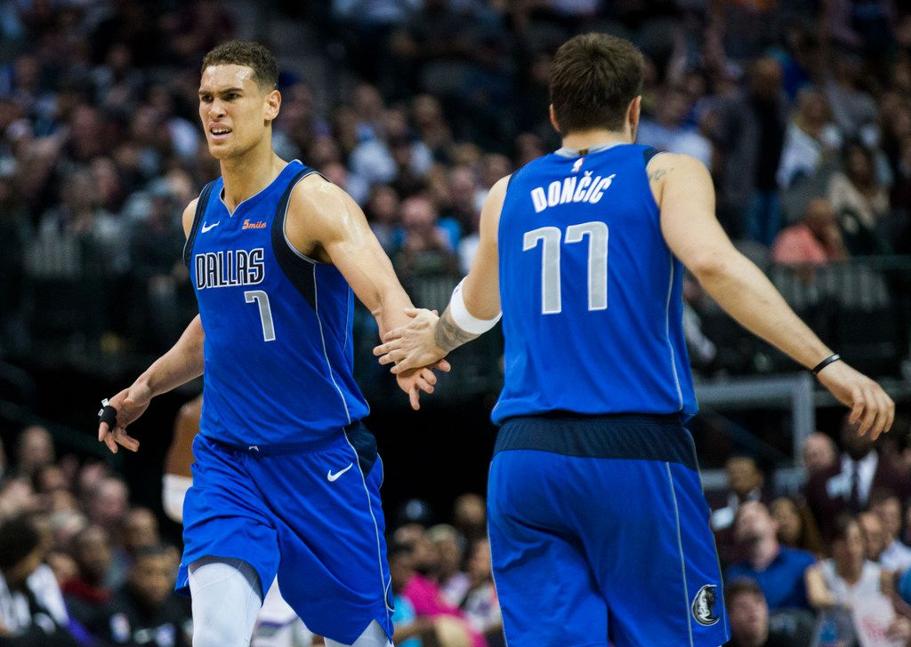 Dallas Mavericks forward Dwight Powell (7) and forward Luka Doncic (77) celebrate a point during the fourth quarter of an NBA game between the Dallas Mavericks and the Sacramento Kings on Tuesday, March 26, 2019 at American Airlines Center in Dallas. (Ashley Landis/The Dallas Morning News)