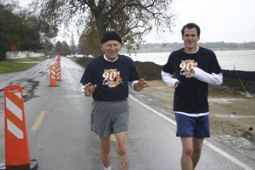 Orville Rogers runs with his grandson at White Rock Lake in celebration of his 90th birthday. He began competing in national track and field events that year.