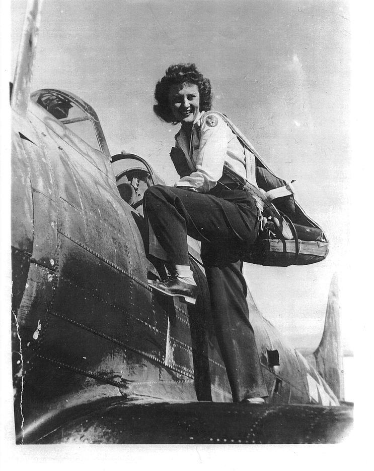 """Muriel """"Mimi"""" Lindstrom Segall climbs into a plane during her service a Women Airforce Service Pilot during World War II. Segall's son, Lindy, will be testifying before the Texas State Board of Education on Tuesday, Nov. 13 in the hopes of reversing the board's decision to cut the WASP from the public school social studies curriculum."""