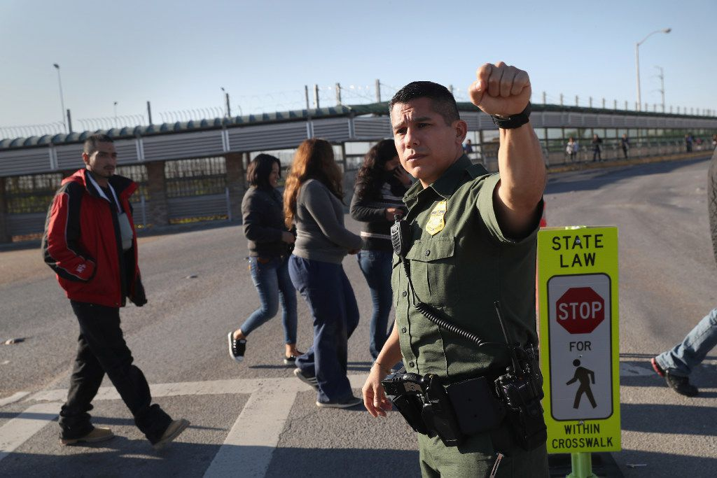 A U.S. Border Patrol agent stops traffic as immigrants are deported across an international bridge into Mexico on March 14, 2017 from Hidalgo, Texas. The Trump administration has ordered an increase in deportations, part of the larger strategy to get tough on illegal immigration and strengthen border security. The U.S. Border Patrol has reported that illegal crossings from Mexico have dropped some 40 percent along the southwest border since Trump took office.