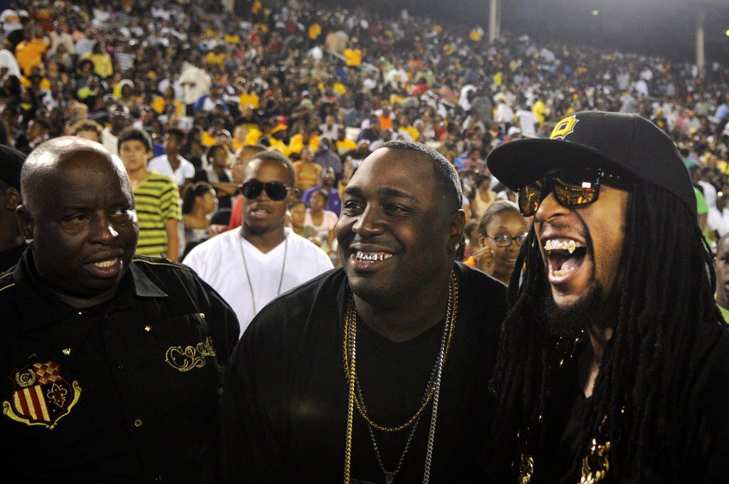 Lil Jon (right), who performed during halftime, poses for a picture with fans on the sidelines during the annual Texas State Fair Classic football game between Prairie View A&M and Grambling State University on Sept. 25, 2010.  Grambling State University won over Prairie View A&M 34-17.