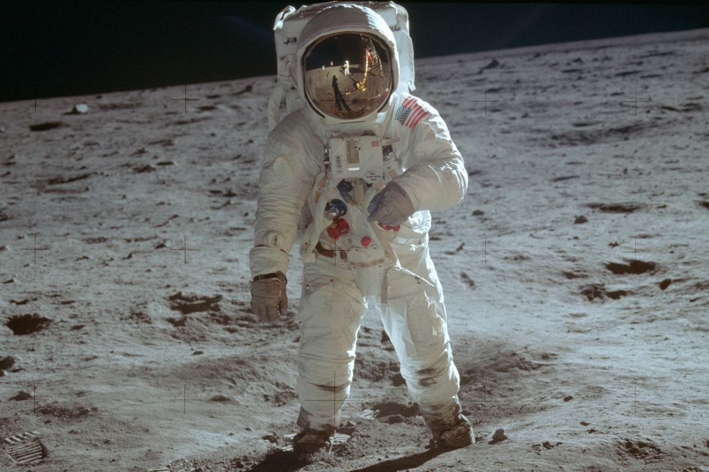 In this July 20, 1969, photo made available by NASA, astronaut Buzz Aldrin, lunar module pilot, walks on the surface of the moon during the Apollo 11 extravehicular activity.