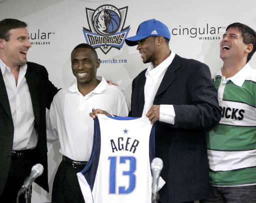 Dallas Mavericks President of Basketball Operations/General Manager Donnie Nelson, Head Coach Avery Johnson, 2006 first round draft pick, Maurice Ager, and Owner Mark Cuban joke about Ager not holding the shirt too high (covering up Johnson) at a press conference at the American Airlines Center Thursday afternoon, June 29, 2006 to introduce Ager.