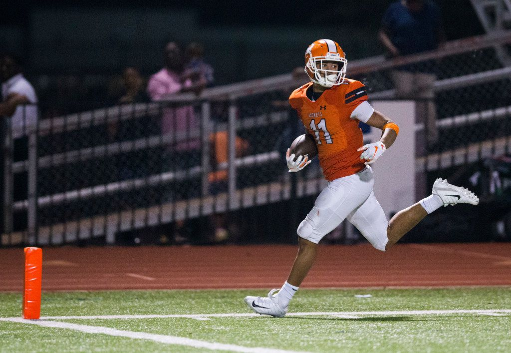 Rockwall wide receiver Jaxon Smith (11) looks back as he runs to the end zone for a touchdown during the third quarter of a District 11 6A high school football game between Longview and Rockwall on Friday, September 28, 2018 at Wilkerson-Sanders Stadium in Rockwall, Texas. (Ashley Landis/The Dallas Morning News)