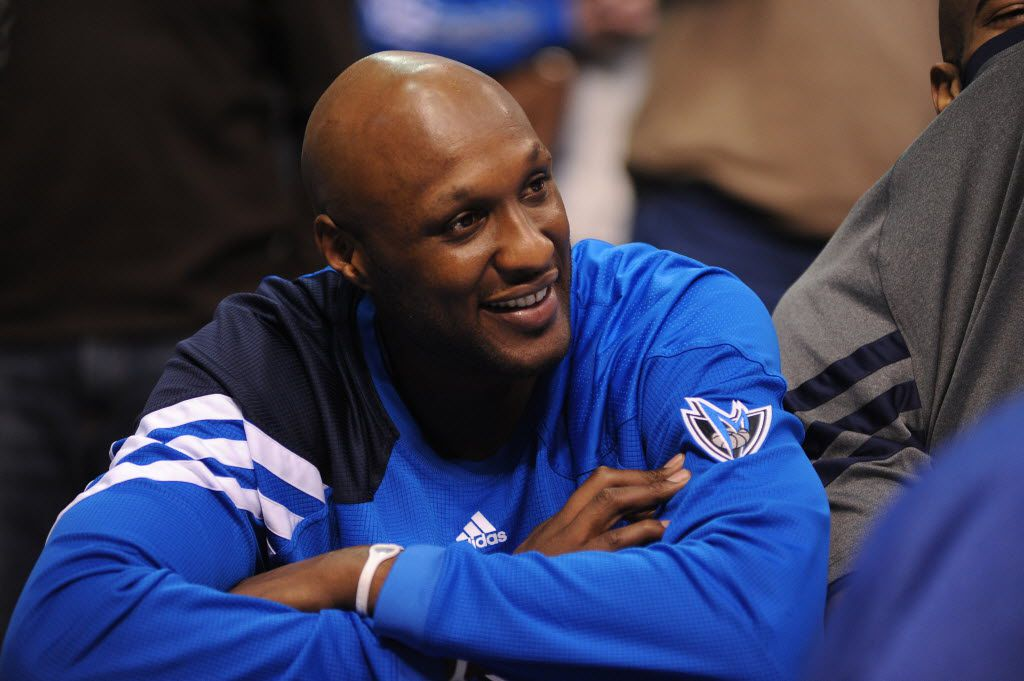 Ex-Mavericks power forward Lamar Odom (7) on the bench during a game against the Utah Jazz at the American Airlines Center in Dallas, Saturday March 3, 2012.