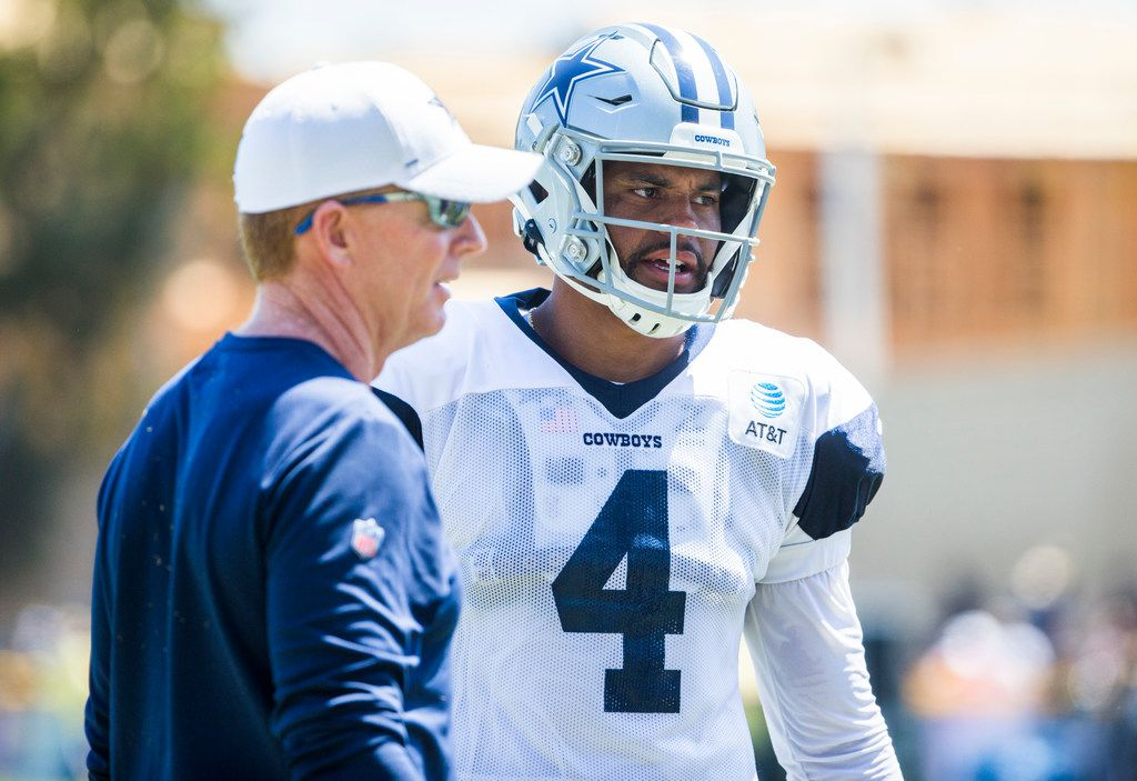 Dallas Cowboys quarterback Dak Prescott (4) talks with head coach Jason Garrett during a morning practice at training camp in Oxnard, California on Thursday, August 8, 2019. (Ashley Landis/The Dallas Morning News)