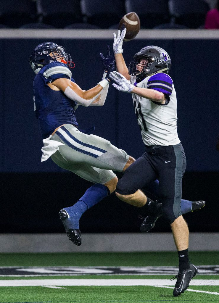 Frisco Lone Star wide receiver Trace Bruckler (4) makes a catch with Frisco Independence defensive back Kade Hubbard (21) during the second quarter of a District 5-5A Division I high school football game between Frisco Independence and Frisco Lone Star on Thursday, October 10, 2019 at the Ford Center at The Star in Frisco. (Ashley Landis/The Dallas Morning News)
