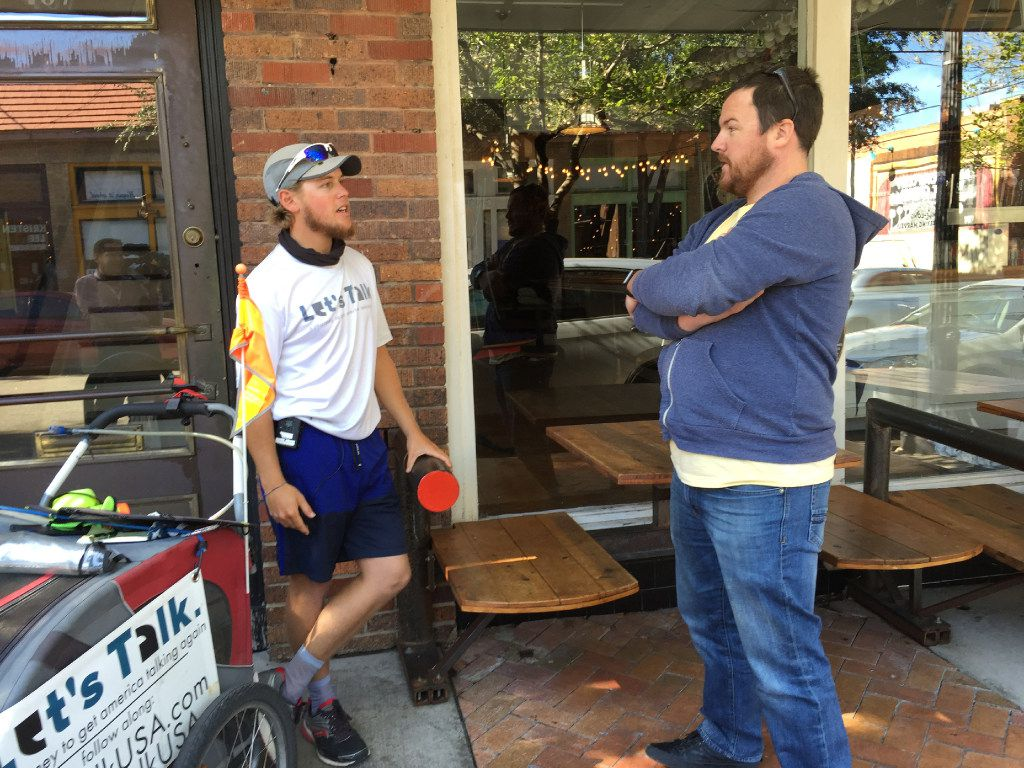 Chris Andrews (left) talked with Mike Goldfuss, owner of Collective Brewing Project in Fort Worth, during Andrews' Let's Talk visit to the Bishop Arts District in Dallas on Monday.
