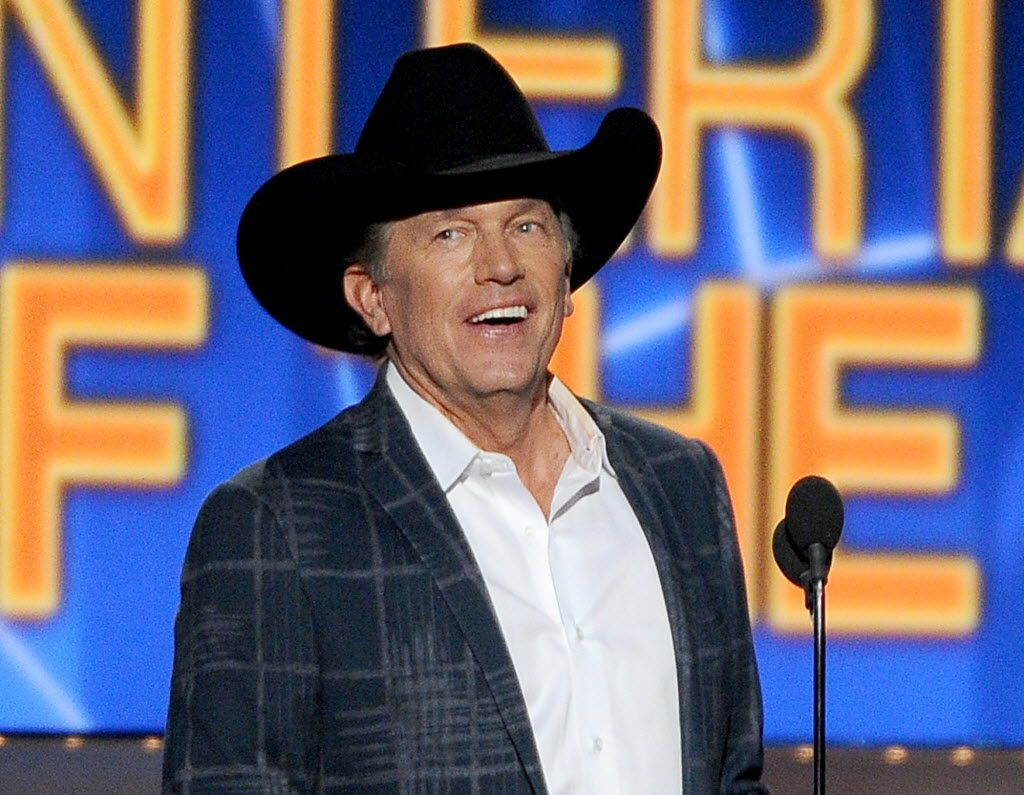 FILE - In this April 6, 2014 file photo, George Strait accepts the award for entertainer of the year at the 49th annual Academy of Country Music Awards in Las Vegas. Strait, along with Amanda Lambert, Kenny Chesney, Taylor Swift, Garth Brooks,  Reba McEntire and Brooks & Dunn will receive a special honor at the Academy of Country Music's 50th awards show on April 19.  (Photo by Chris Pizzello/Invision/AP, File) / mug - mugshot - headshot / 04192015xNEWS