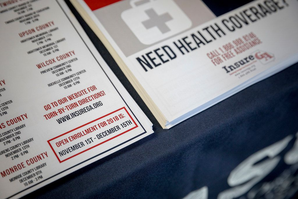 Information about open enrollment in the Affordable Care Act from Insure Georgia at a child safety expo in Macon, Ga., Oct. 28, 2017. As the ACA's fifth open enrollment period starts, the law is reeling from continued attacks by President Trump that have sown confusion and anxiety among the roughly 10 million Americans with coverage through its insurance marketplaces and millions more who remain uninsured. (Audra Melton/The New York Times)