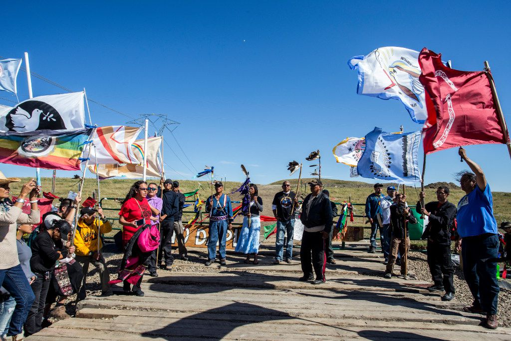 Activists and Native Americans  march to the sacred site in Cannonball, North Dakota on Wednesday, Sep14th, 2016. Thousands of indigenous people and activists are living in camps on the Standing Rock reservation as they protest the construction of a new oil pipeline. Construction has been halted after the Obama administration decision to suspend construction on a controversial oil pipeline in North Dakota.  (Jeenah Moon/Special Contributor)