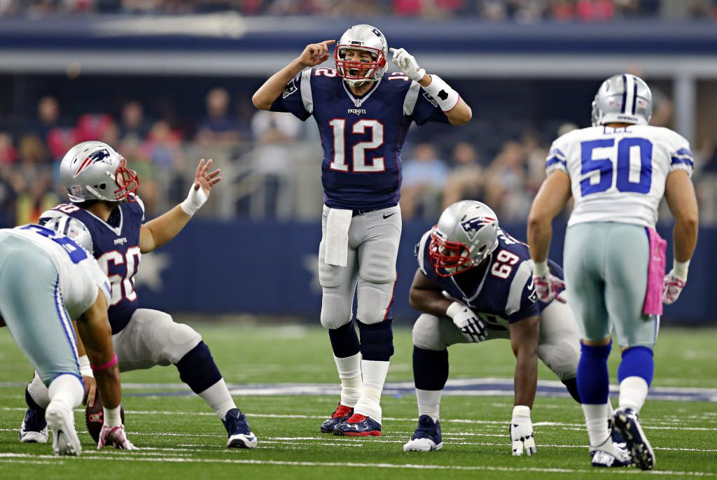 New England Patriots quarterback Tom Brady (12) calls a play at the line during the first half against the Dallas Cowboys Sunday, October 11, 2015 at AT&T Stadium in Arlington, Texas.
