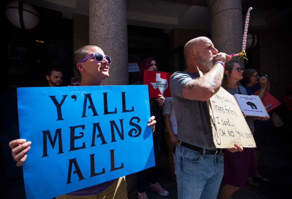 Siobhan Cooke of Nacogdoches, Texas and Mark Jiminez of Dallas are among protestors rallying against the so-called bathroom bill on the fourth day of a special legislative session on Friday, July 21, 2017 at the Texas state capitol in Austin, Texas. Legislation being debated would restrict the bathrooms available for use to transgender people. Sen. Lois Kolkhorst, R-Brenham, said she authored the bill because she wants to protect the privacy and dignity of Texas women and girls. (Ashley Landis/The Dallas Morning News)