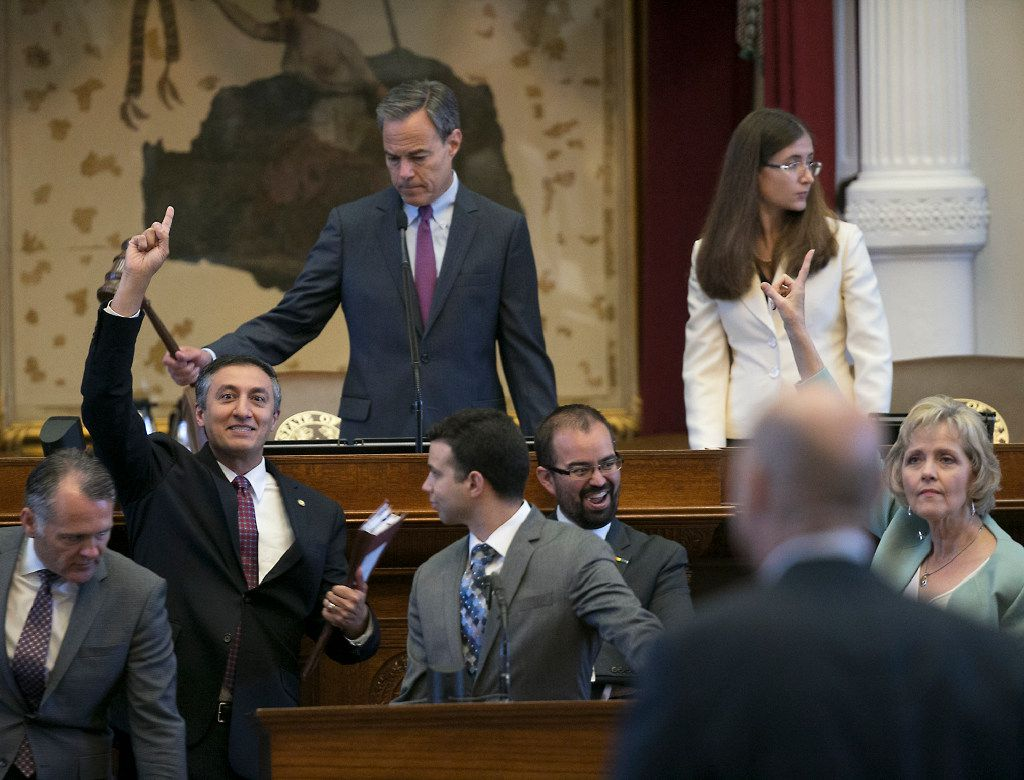 House Speaker Joe Straus keeps order on the House floor Thursday, July 27, 2017 in Austin as Rep. Giovanni Capriglione, R-Southlake, signals for passage of his bill.