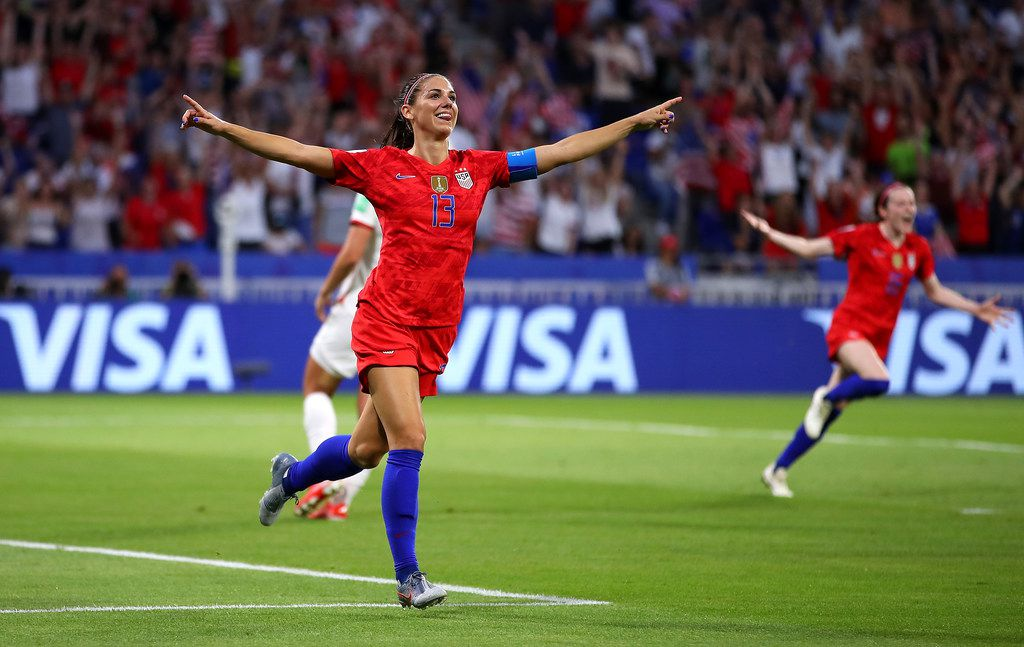LYON, FRANCE - JULY 02: Alex Morgan of the USA celebrates after scoring her team's second goal during the 2019 FIFA Women's World Cup France Semi Final match between England and USA at Stade de Lyon on July 02, 2019 in Lyon, France. (Photo by Richard Heathcote/Getty Images)