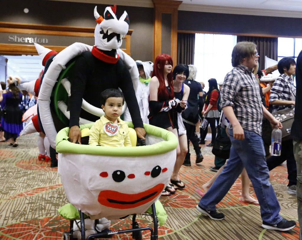 Mike Skellington as Dry Bowser and eighteen-month-old Darien Skellington as Bowser Jr. make their way through the crowd at AnimeFest 2015.