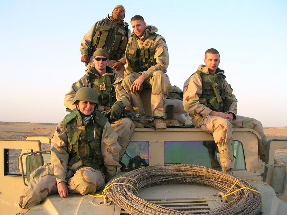 AIr Force veteran Brian Kolfage (middle, seated) has created a GoFundMe page to help fund a border wall between the U.S. and Mexico. He was severely injured in Iraq in 2004.