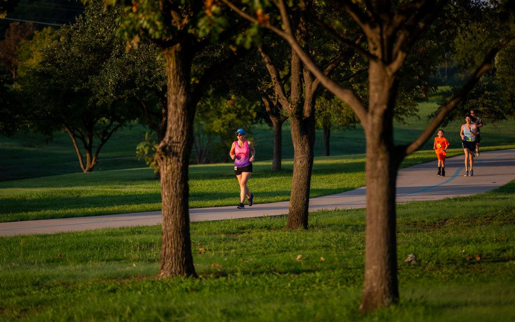 Amie Goins, left, runs a 5k at at the Josey Ranch Athletic Complex in Carrollton.