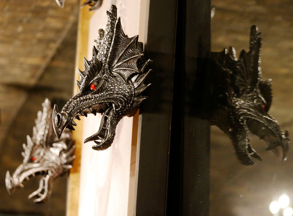 Dragons on the wall next to a portrait of Queen Elizabeth at the Ill Minster Pub in Dallas