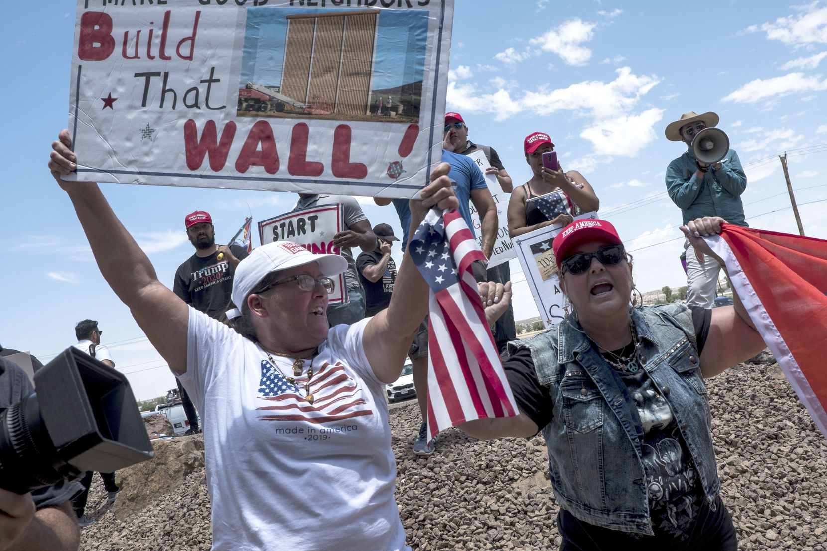 Trump supporters demonstrate outside a Customs and Border Protection station in Clint on Monday during a visit by the Congressional Hispanic Caucus.