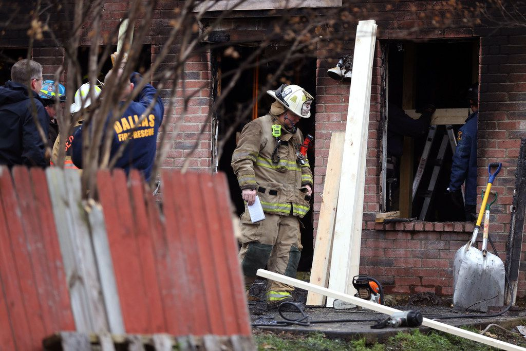 Dallas and Cedar Hill fire-rescue workers reinforce a house that caught fire early Thursday morning. Three people died house in the 700 block of Lovern Street in Cedar Hill.