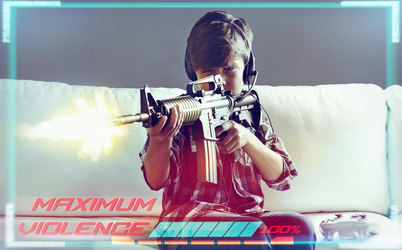 Un niño juega con un arma para interactuar con un videojuego.(GETTY IMAGES)
