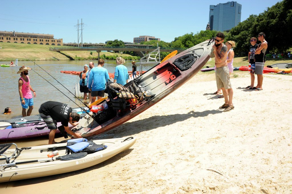 Canoers set up their equipment before taking off at Sunday Funday.