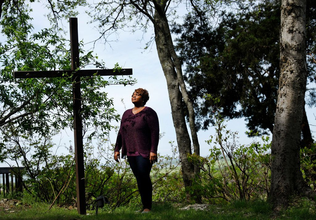 Amber Johnson of Grand Prairie is photographed on April 5, 2018 at a hilltop lookout point in far southwest Dallas where she often goes to pray. Prayer has helped her with the anxiety she said she developed after she experienced workplace sexual harassment.
