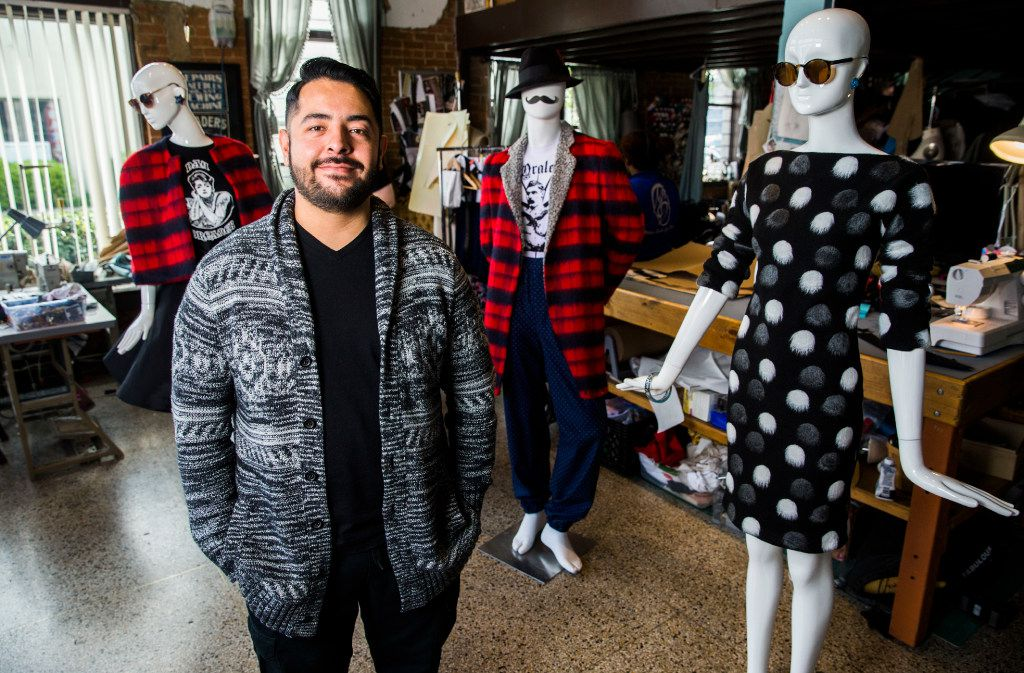 Dallas-based designer Mario Alberto Gallegos poses for a portrait with selections from the fall line for La New Onda, designed by Gallegos,  at Petit Atelier in Deep Ellum. Gallegos's show, Forever & Evermore, which features work reminiscent of 1940s and 1950s Mexican style, is on March 16 at the Margo Jones Theater.