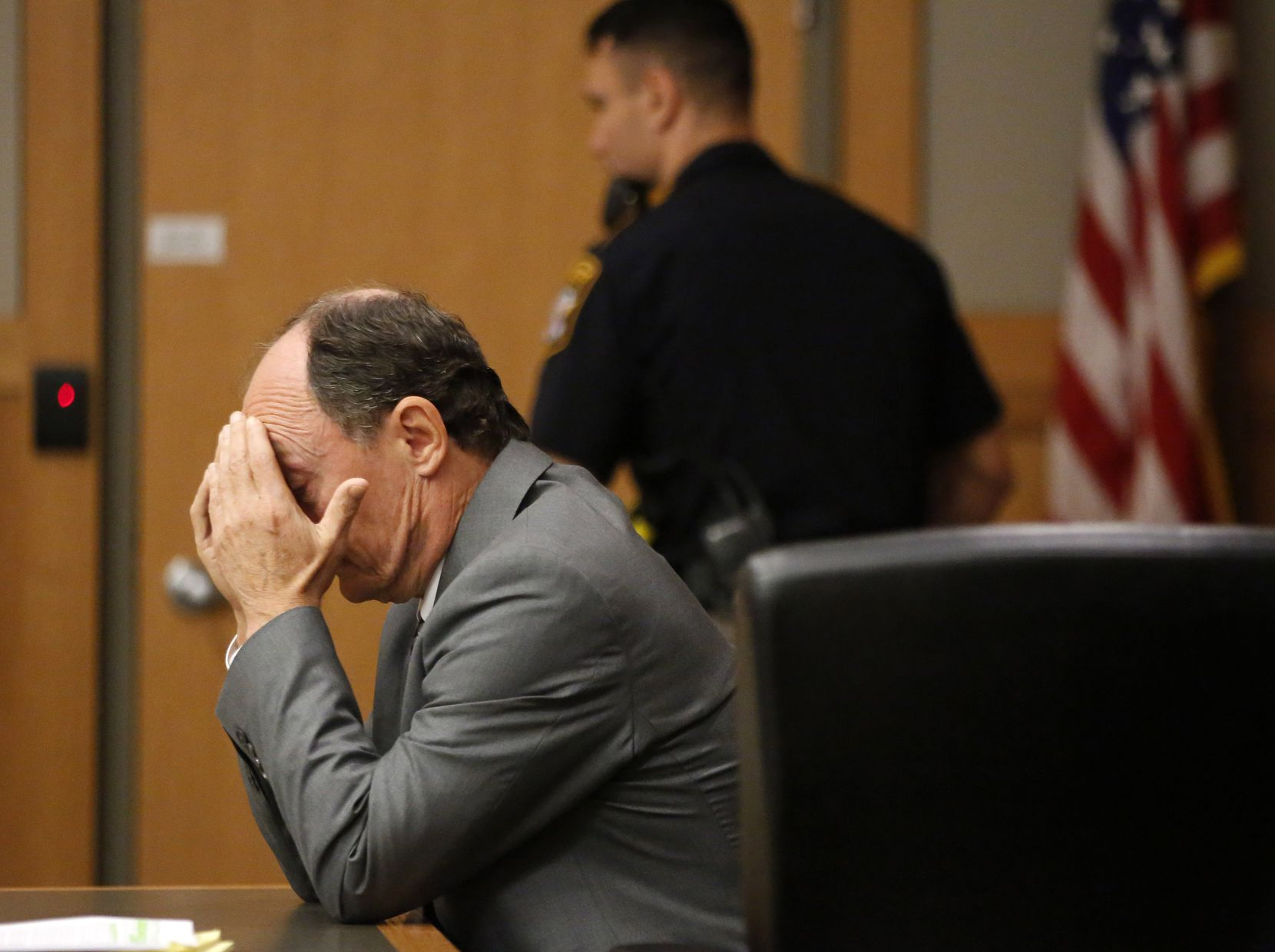 Defendant Robert Moses of Frisco reacts to the guilty verdict handed to him by a jury Thursday. Moses was found guilty in killing his ex-wife Anna Moses.