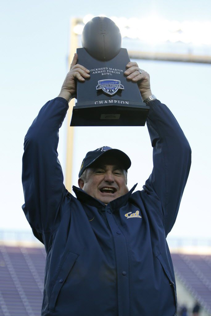 California Golden Bears head coach Sonny Dykes holds up the Lockheed Martin Armed Forces Bowl championship trophy after winning against the Air Force Falcons at Amon G. Carter Stadium in Fort Worth, Texas on Dec. 29, 2015. (Rose Baca/The Dallas Morning News)