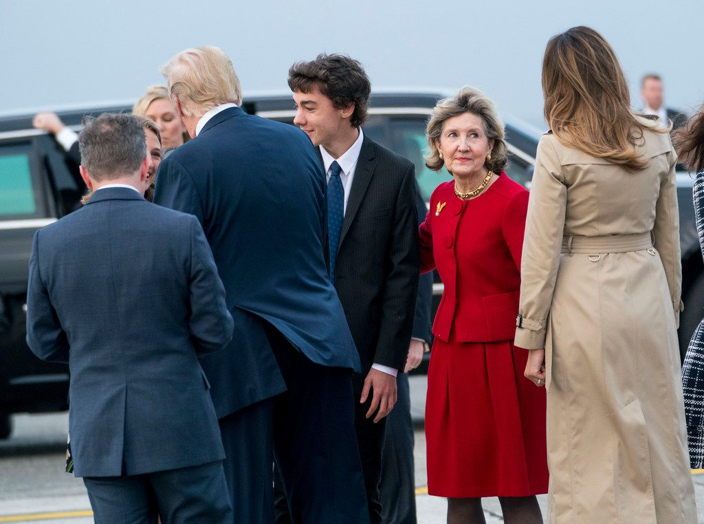 Kay Bailey Hutchison, the U.S. ambassador to NATO,  with President Donald Trump and first lady Melania Trump as they arrived on Air Force One at Melsbroek Air Base in Brussels on July 10, 2018.