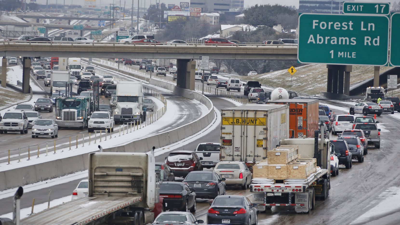 Traffic stacks up on LBJ 635 as police work an accident in northeast Dallas on Thursday. (File Photo/Louis DeLuca)