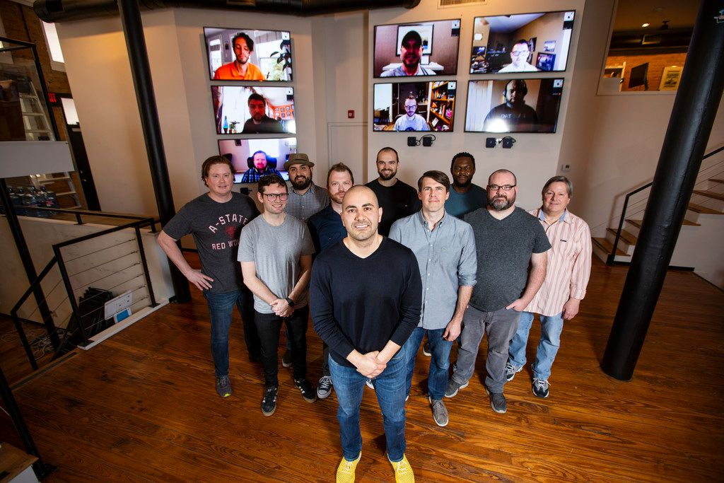 Mark Haidar, center, cofounder and CEO of Vinli, with his local and remote team members at Vinli's office in Dallas. About half of the company's employees work remotely.