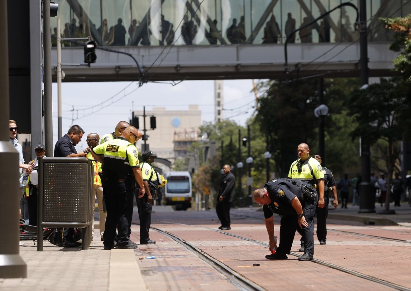 DART police investigate the scene where a Dallas police officer was hit by a DART train near the intersection of Bryan Street  and Olive Street in downtown Dallas on Tuesday, Aug. 13, 2019.