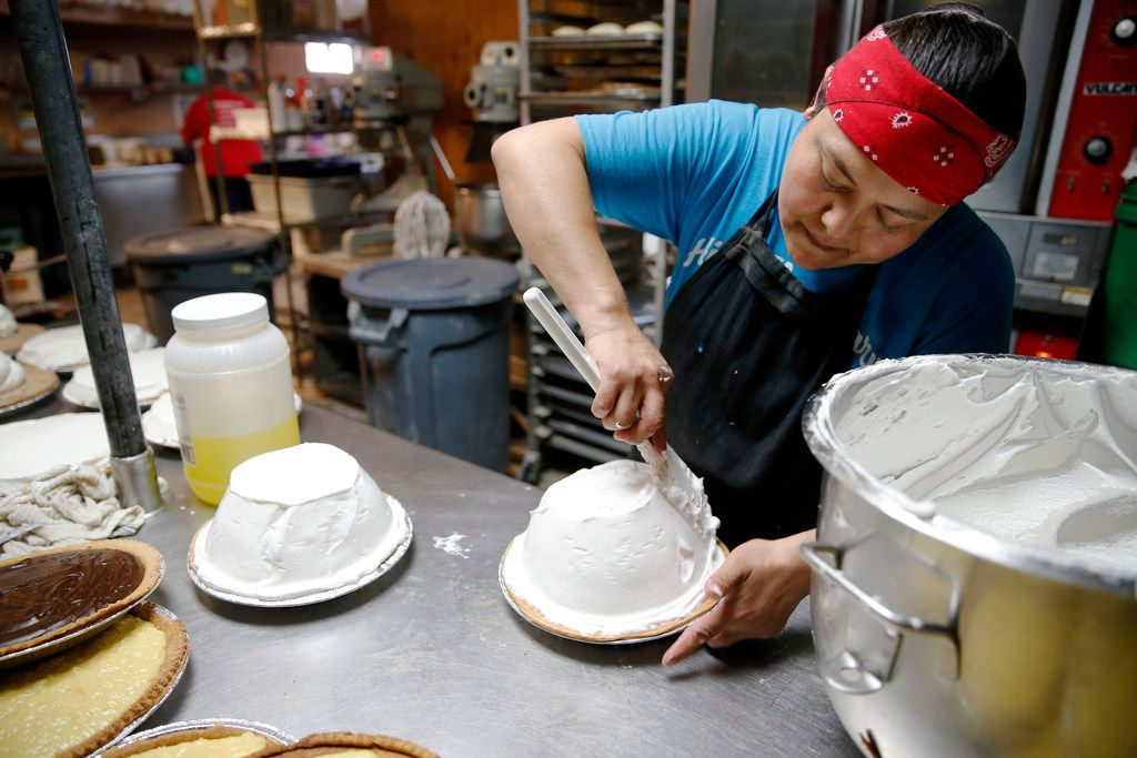 Adela Rangel works on applying meringue to pies before placing in the oven at Koffee Kup Family Restaurant in Hico, Texas on Friday, March 16, 2018. Rangel makes 90-100 pies a day.