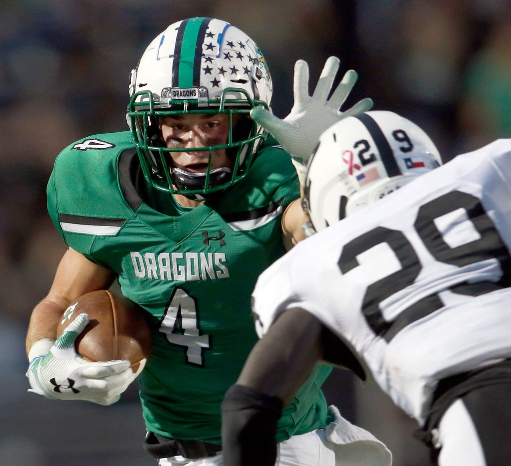 Southlake Carroll running back T.J. McDaniel (4) prepares to stiff arm Odessa Permian cornerback Rakeeb Adeyemi (29) during a long second quarter rush which set up a Dragons field goal. The two teams played their non-district  football game at Southlake Carroll's Dragon Stadium in Southlake on September 14, 2018.  (Steve Hamm/ Special Contributor)