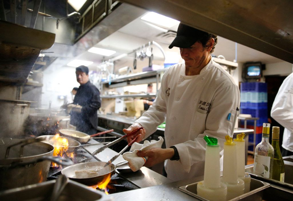 Sous Chef Will Sorto works on the last dish of the night on the last day of business at the Palm Restaurant in Dallas on Friday, June 30, 2017.