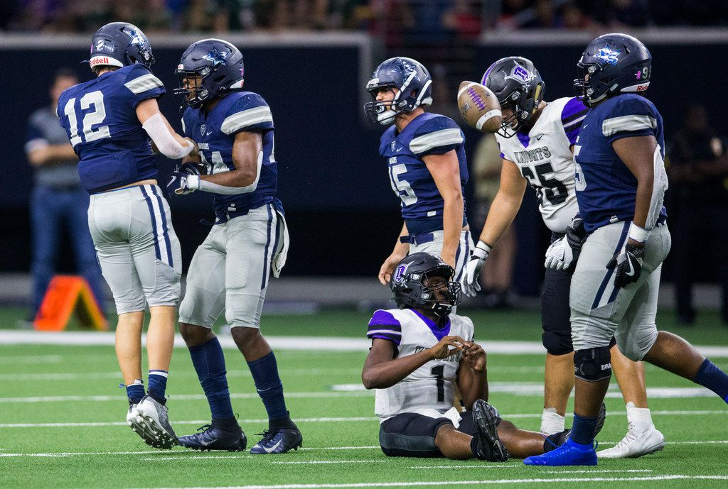Frisco Independence quarterback Braylon Braxton (1) sits on the turf after he was sacked by Frisco Lone Star linebacker Blake Gotcher (12) during the second quarter of a District 5-5A Division I high school football game between Frisco Independence and Frisco Lone Star on Thursday, October 10, 2019 at the Ford Center at The Star in Frisco. (Ashley Landis/The Dallas Morning News)