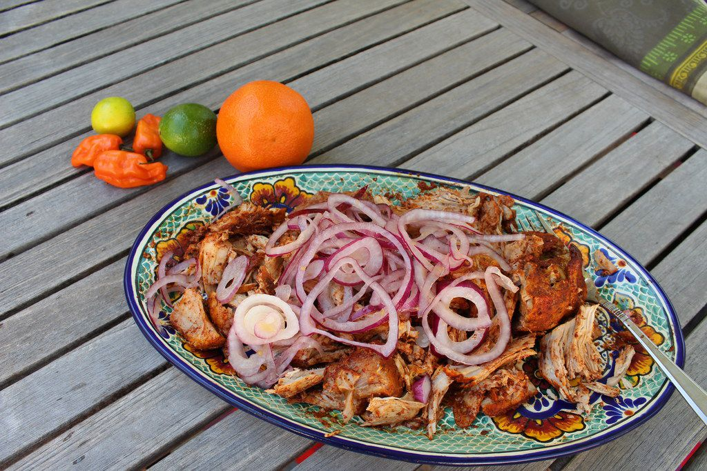 A platter of cochinita pibil, Yucatan slow-cooked pork, fresh from the slow cooker. The recipe is from Texas Slow Cooker.