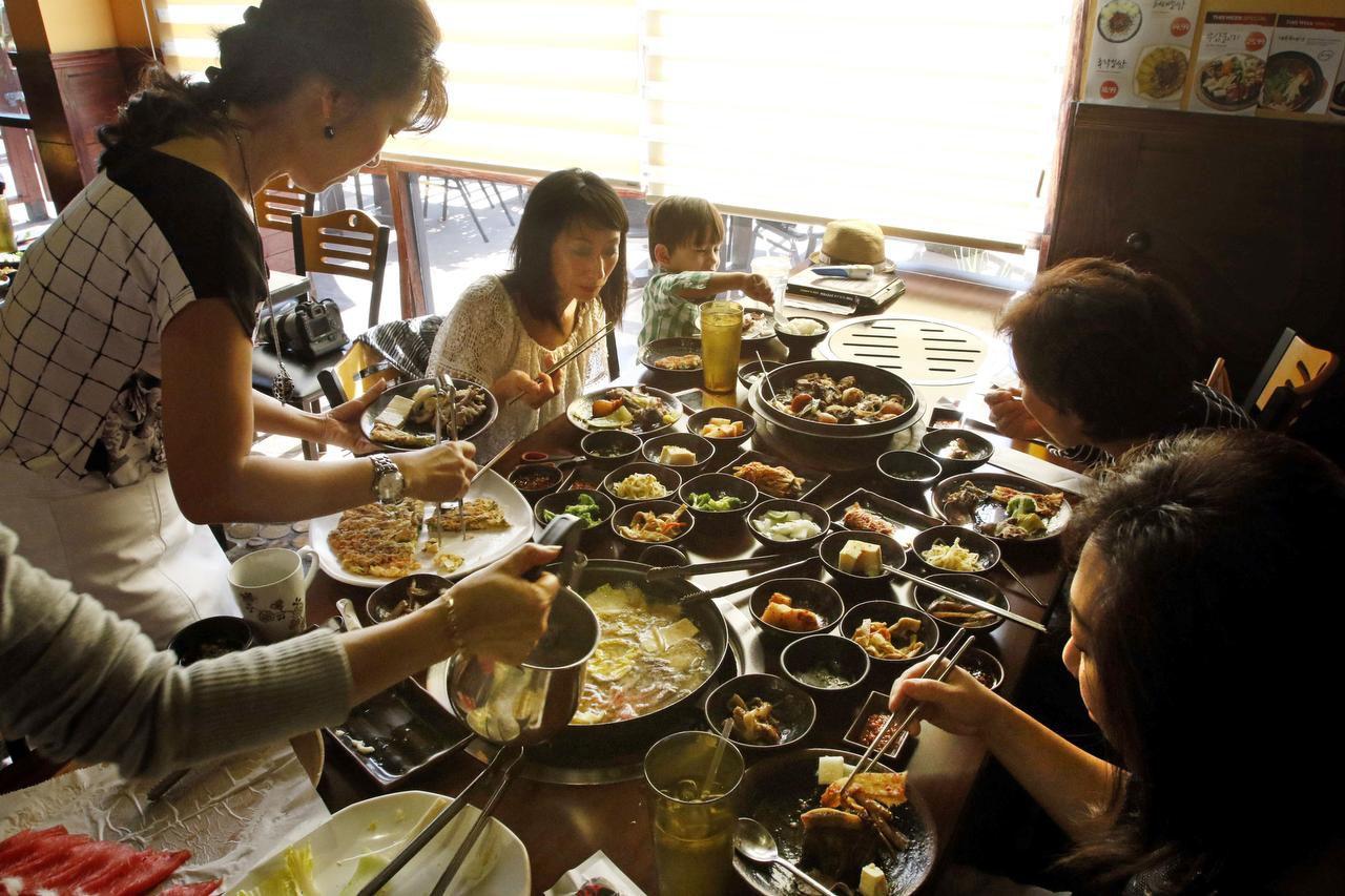 Cheryl Collett (second from left) and her friends enjoy Shabu Shabu at Ssam Korean Grill in Korean town in Carrollton.