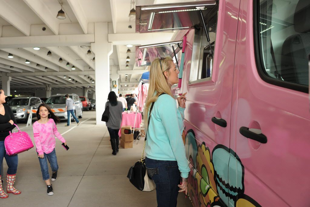 Stephanie Gunter places her order at the window at the Hello Kitty Cafe Truck at The Shops at Willow Bend in Plano, TX on March 12, 2016. (Alexandra Olivia/ Special Contributor)