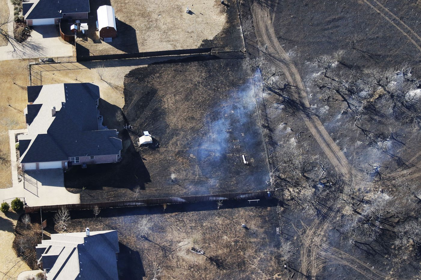 Homes were threatened by a grass fire west of Fort Worth, Texas, on Monday January 22, 2018.